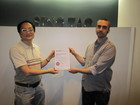 The plant manager and project manager display the certificate.